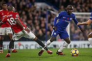 N'golo Kante of Chelsea dribbles away from Ashley Young of Manchester United . Premier league match, Chelsea v Manchester United at Stamford Bridge in London on Sunday 5th November 2017.<br /> pic by Kieran Clarke, Andrew Orchard sports photography.