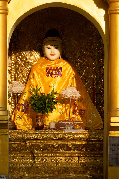 Statues in the Shwedagon Pagoda complex. situated on Singuttara Hill in the center of Yangon (Rangoon). It is the most sacred Buddhist stupa in Myanmar and one of the most important religious reliquary monuments in the world