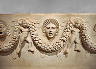 """Close up picture of Roman relief sculpted Sarcophagus of Garlands, 2nd century AD, Perge. This type of sarcophagus is described as a """"Pamphylia Type Sarcophagus"""". It is known that these sarcophagi garlanded tombs originated in Perge and manufactured in the sculptural workshops of Perge. Antalya Archaeology Museum, Turkey. .<br /> <br /> If you prefer to buy from our ALAMY STOCK LIBRARY page at https://www.alamy.com/portfolio/paul-williams-funkystock/greco-roman-sculptures.html . Type -    Antalya    - into LOWER SEARCH WITHIN GALLERY box - Refine search by adding a subject, place, background colour, etc.<br /> <br /> Visit our ROMAN WORLD PHOTO COLLECTIONS for more photos to download or buy as wall art prints https://funkystock.photoshelter.com/gallery-collection/The-Romans-Art-Artefacts-Antiquities-Historic-Sites-Pictures-Images/C0000r2uLJJo9_s0"""