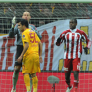 Galatasaray's Engin Baytar (L) and Sivasspor's goalkeeper Milan Borjan (B), Doudou Jacques Faty (R) during their Turkish Superleague soccer match Galatasaray between Sivasspor at the Turk Telekom Arena at Aslantepe in Istanbul Turkey on Saturday 26 November 2011. Photo by TURKPIX