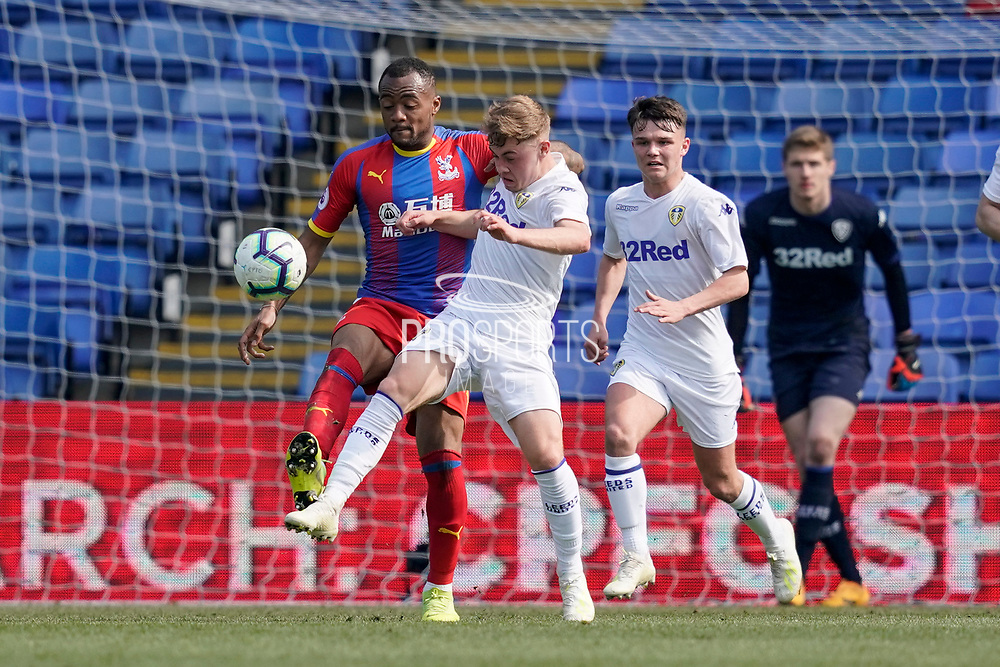 Alfie Mccalmont of Leeds United U23 under pressure during the U23 Professional Development League match between U23 Crystal Palace and Leeds United at Selhurst Park, London, England on 15 April 2019.
