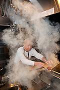 NEW YORK, NY - November  8, 2017:  Chef Masa Takayama prepares hamburgers at the basement grill at Tetsu, his new casual restaurant in TriBeCa.<br /> <br /> CREDIT: Clay Williams for The New York Times.<br /> <br /> © Clay Williams / claywilliamsphoto.com