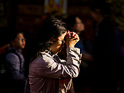 21 DECEMBER 2017 - HANOI, VIETNAM: A woman prays in St. Joseph's Cathedral in Hanoi. The cathedral was one of the first buildings constructed by the French colonial government and opened in 1886. It is the oldest and largest Catholic church in Hanoi.   PHOTO BY JACK KURTZ