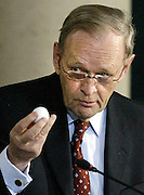 LOC / Ottawa / Feb 8, 2005...Former Prime Minister Jean Chretien holds up a golf ball given to him by the Presedent of the United Sates as he testify's to Judge John Gomery at the sponsorship inquiry in Ottawa, Tuesday, Feb 8, 2005...(Ottawa Sun Photo By Sean Kilpatrick) #2703