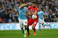 Sergio Aguero of Manchester City (l) and Emre Can of Liverpool battle for the ball. Capital One Cup Final, Liverpool v Manchester City at Wembley stadium in London, England on Sunday 28th Feb 2016. pic by Chris Stading, Andrew Orchard sports photography.