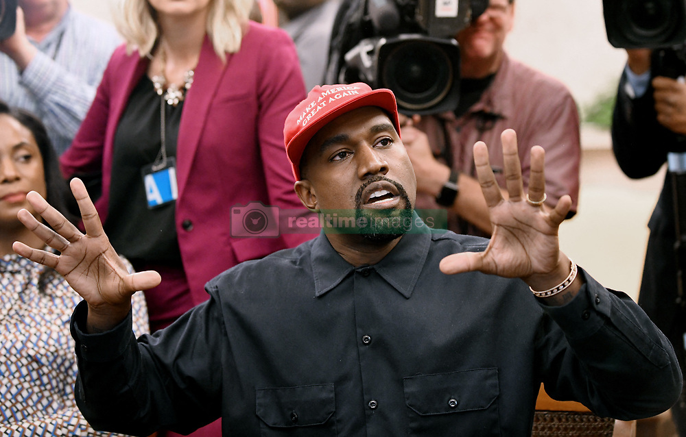 """File photo of Artist Kanye West speaks in the Oval Office of the White House during a meeting with President Trump to discuss criminal justice system and prison reform on October 11, 2018 in Washington, DC. Kim Kardashian West spoke out about Kanye West's bipolar disorder Wednesday, three days after the rapper delivered a lengthy monologue at a campaign event touching on topics from abortion to Harriet Tubman, and after he said he has been trying to divorce her.Kardashian West said in a statement posted in an Instagram Story that she has never spoken publicly about how West's bipolar disorder has affected their family because she is very protective of their children and her husband's """"right to privacy when it comes to his health."""" Photo by Olivier Douliery/ Abaca Press"""