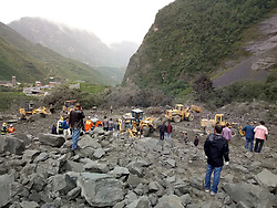 June 24, 2017 - Maoxian, china - Rescue workers at the accident site after a landslide occurred in Xinmo Village of Maoxian County, Tibetan and Qiang Autonomous Prefecture, southwest China's Sichuan Province. The landslide on Sunday morning smashed some 40 homes, where about 100 people are feared to be buried. (Credit Image: © Xinhua via ZUMA Wire)