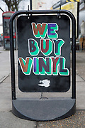We Buy Vinyl sign outside Flashback record shop on the 27th March 2018 in Islington, North London in the United Kingdom.