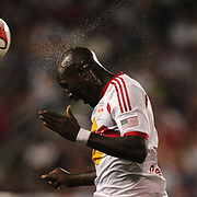 Ibrahim Sekagya, New York Red Bulls, heads clear during the New York Red Bulls Vs Seattle Sounders, Major League Soccer regular season match at Red Bull Arena, Harrison, New Jersey. USA. 20th September 2014. Photo Tim Clayton