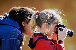 Young Girl Learning To Photograph In The Everglades