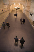 commuters walking through a large hallway in Grand Central train station New York City