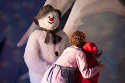 30/11/2011. London, UK. London's favourite family Christmas show based on Raymond Briggs' book The Snowman and featuring Howard Blake's much-loved score returns to the West End's Peacock Theatre for a record-breaking 14th consecutive year. Picture shows James Leece as the Snowman, Charlie Salsen as The Boy & Alessandra Mazzetti as Mum. Photo credit : Tony Nandi/LNP