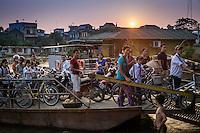VAN HA, VIETNAM - CIRCA SEPTEMBER 2014: People coming to the Lang Gom Tho Ha via ferry, the village belongs to the Van Ha commune, it is located 50km away from Hanoi in Northern Vietman