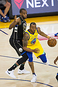 Golden State Warriors forward Andre Iguodala (9) handles the ball against the Milwaukee Bucks at Oracle Arena in Oakland, Calif., on March 29, 2018. (Stan Olszewski/Special to S.F. Examiner)