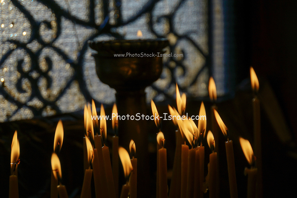 Lit candles in the interior of Agios Georgios (St. George) chapel at the top of the Lycavittos hill in Athens, Greece