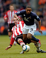 Photo. Jed Wee.<br /> Southampton v Tottenham Hotspur, Barclays Premiership, 05/03/2005.<br /> Spurs' Jermain Defoe (R) tries to get away from the lunging tackle of Southampton's Danny Higginbotham.