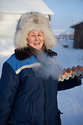 The Pole of Cold - local inhabitant at the village of Tomtor with eggs. The area is extremely cold during the winter. Two towns by the highway, Tomtor and Oymyakon, both claim the coldest inhabited place on earth (often referred to as -71.2°C, but might be -67.7°C) outside of Antarctica. The average temperature in Oymyakon in January is -42°C (daily maximum) and -50°C (daily minimum). The images had been made during an outside temperature in between -50°C up to -55°C. Tomtor, Jakutien, Yakutia, Russian Federation, Russia, RUS, 19.01.2010