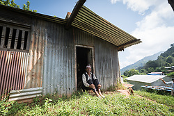 17 September 2018, Kavre district, Nepal: Orsun Prosat Tivari rests by the door to his home in Maidan. In the community of Maidan, Kavre district, villagers have started to practice semi-commercial vegetable farming, through support from the LWF World Service programme's Post-Earthquake Rehabilitation and Livelihood Recovery Project. Through a collection centre, villagers gather what surplus they have, and bring it collectively to the market in the nearby town of Kuntabesi. Struck hard by the 2015 eatrhquake, the community has also worked hard to rebuild their houses and homes in the past three years.