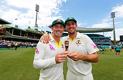 Australia's Shaun and Mitch Marsh celebrate winning the ashes during day five of the Ashes Test match at Sydney Cricket Ground.