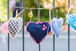 © Licensed to London News Pictures. 22/05/2018. Manchester UK. Picture shows hearts attached to railings outside Victoria station in Manchester this morning which is marking the first anniversary of the Manchester Arena bombing. 22 people died when Salman Abedi detonated a bomb at an Ariana Grande concert. Photo credit: Andrew McCaren/LNP
