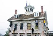 Painters prepare house for new paint, Provincetown, Cape Cod MA