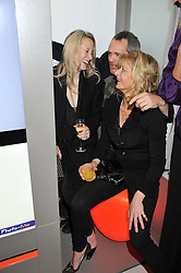 "Left to right, RICHARD & SOPHIE BRAINE and ALISON JACKSON at the launch of ""Photo-Me by Starck"" – a photobooth exclusively designed by the world renowned artist and creator Philippe Starck held at The Saatchi Gallery, Duke Of York Square, Kings Road, London on 2nd November 2011."