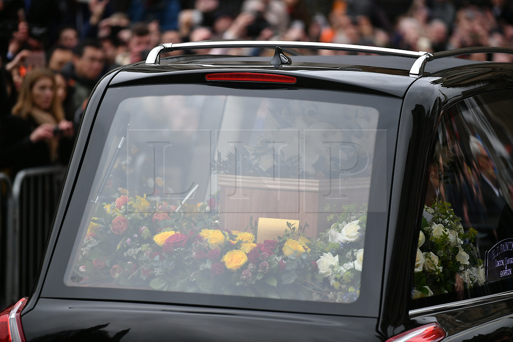 © Licensed to London News Pictures. 31/03/2018. Cambridge, UK. The funeral of Stephen Hawking at Church of St Mary the Great in Cambridge, Cambridgeshire. Professor Hawking, who was famous for ground-breaking work on singularities and black hole mechanics, suffered from motor neurone disease from the age of 21. He died at his Cambridge home in the morning of 14 March 2018, at the age of 76. Photo credit: Ben Cawthra/LNP