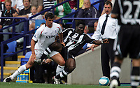 Photo: Paul Thomas. <br />Bolton Wanderers v Newcastle United. Barclays Premiership. 11/08/2007. <br /><br />Goal scorer Obafemi Martins of Newcastle gets tackled by Gary Speed (L), which is watched by Newcastle manager Sam Allardyce (R), which later he isn't happy with.