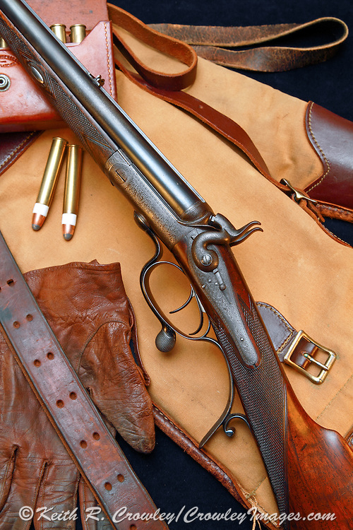 Boss & Co under-lever double rifle manufactured in 1874, with ammunition and accessories.