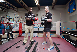 © Licensed to London News Pictures.10/04/2012. London, UK.  The Liberal Democrat mayoral candidate Brian Paddick spars with former Commonwealth and European heavyweight champion Derek Williams after he  launched his manifesto at the Pedro Youth Club in Homerton today .Photo credit : James Gourley/LNP