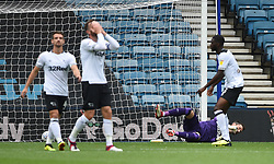 Derby County goalkeeper Scott Carson is beaten for the second goal scored by Millwall's Shaun Williams with a large deflection
