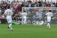 Swansea city's Michu (9) bundles the ball over the line for his sides 2nd goal. Barclays Premier league, Swansea city  v West Ham Utd at the Liberty Stadium in Swansea, South Wales  on Saturday 25th August 2012. pic by Andrew Orchard, Andrew Orchard sports photography,