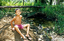 Indigenous boy who has become blind due to the toxicity of the contaminated water that sustains his people.