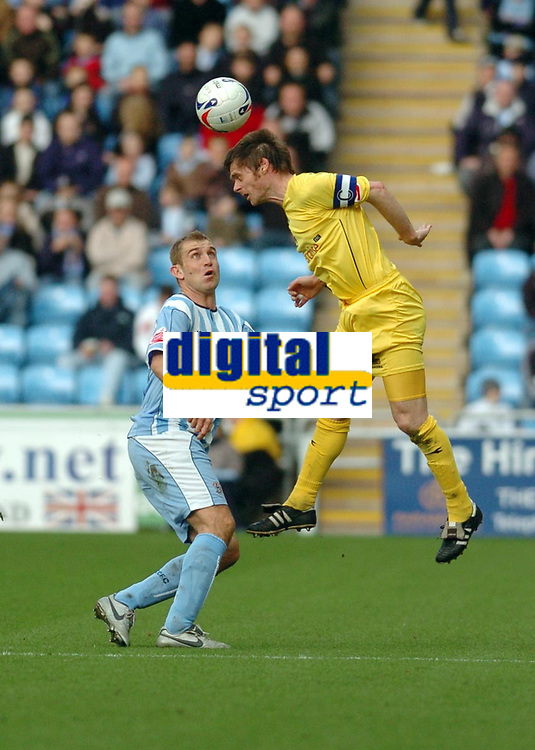 Photo: Leigh Quinnell.<br /> Coventry City v Preston North End. Coca Cola Championship. 01/04/2006. Prestons Graham Alexander reaches the ball before Coventrys James Scowcroft.