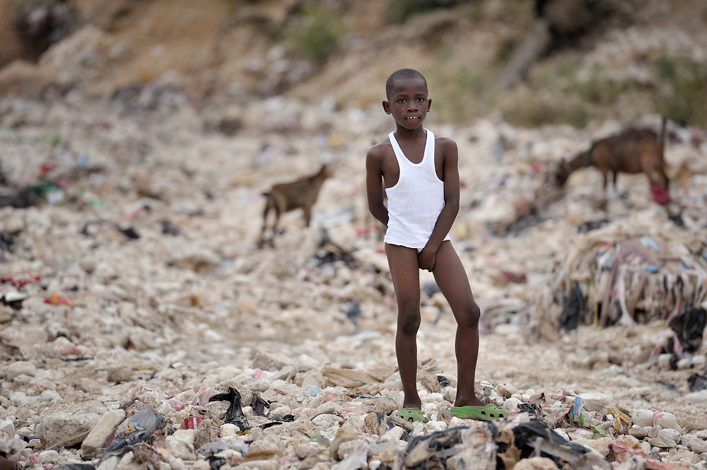 """A young boy living in a """"tent city"""" of homeless earthquake survivors in the Bobin neighborhood of Port-au-Prince, Haiti. The January 2010 earthquake ravaged the capital, killing some 300,000 people and leaving more than 1.3 million homeless."""