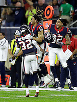 Houston Texans' Will Fuller (15) and Robert Nelson (32) celebrate after an NFL football game against the Cincinnati Bengals Texans Saturday, Dec. 24, 2016, in Houston. The Texans won 12-10. (AP Photo/Sam Craft)
