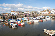 Moored boats in the harbour at West Bay, Bridport, Dorset, England, UK