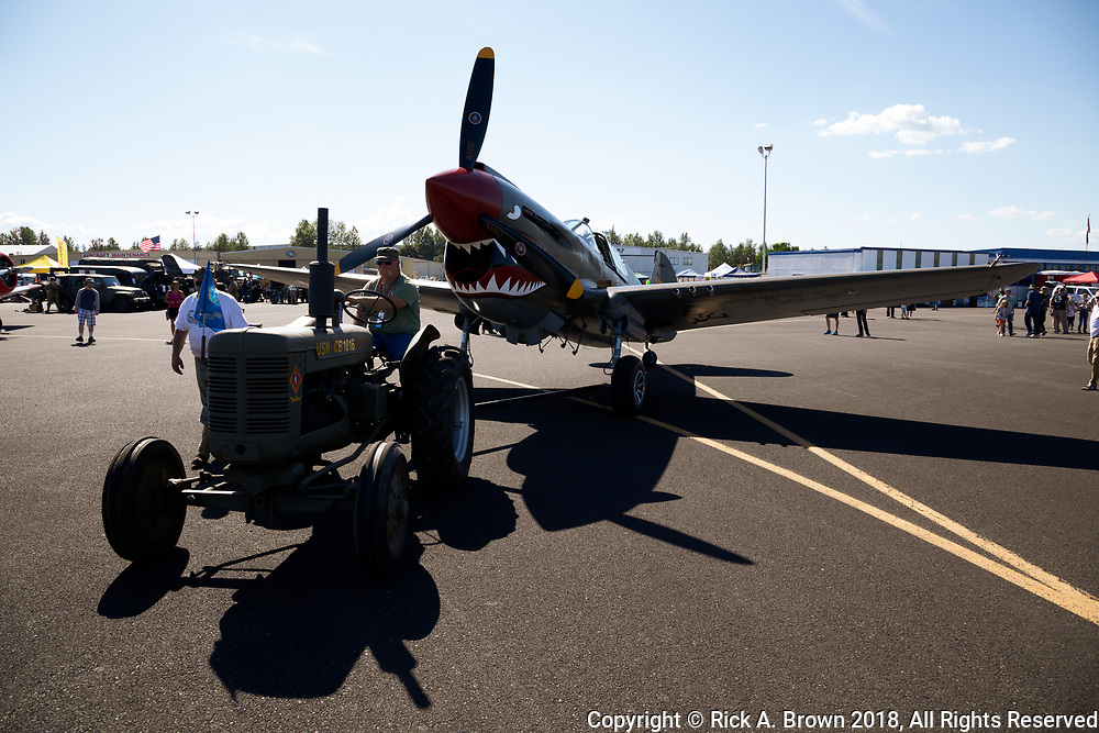 WWII era Navy tractor towing P-40E Warhawk at Warbirds Over the West.