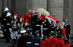 © Licensed to London News Pictures. 17 April 2013. St Paul's Cathedral London. The coffin emerges from St Paul's at the end of the service carried by the servicemen pall bearers. Funeral of Baroness Thatcher, former Conservative Prime Minister. Photo credit : MarkHemsworth/LNP