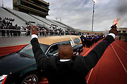 """ORG XMIT: *S0425655558* (02/07/09) -- A starting gun is fired as the coffin of Sharla Lashawn Butler, a senior at Lancaster High School, begins a """"victory lap"""" around the track at Beverly D. Humphrey Stadium in Lancaster before processing to the funeral service Saturday February 9, 2009.  Butler died of encephalitis this week.  (Courtney Perry/The Dallas Morning News.) <br /> 02082009xMETRO"""