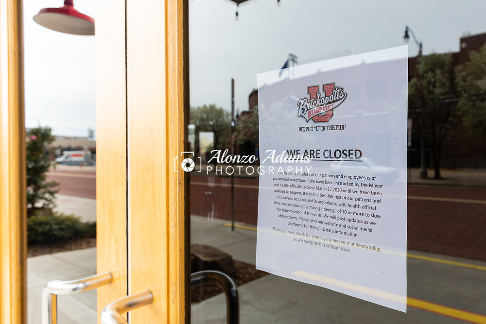 A sign on Brickopolis in the Bricktown Entertainment District of Oklahoma City advises customers that they had to close upon request of the Mayor to slow the spread of the COVID-19 virus on Saturday, March 21, 2020. Photo copyright © 2020 Alonzo J. Adams.
