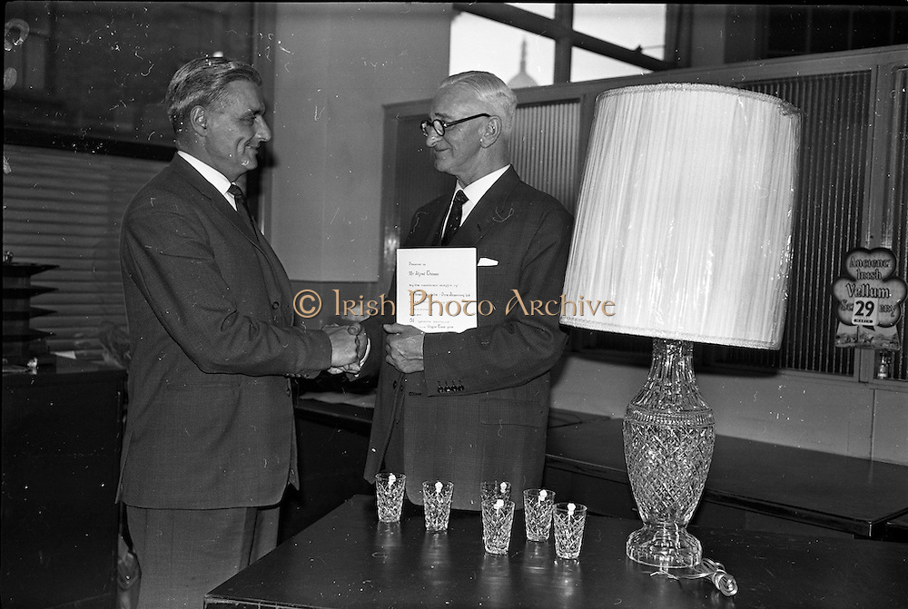 29/03/1963<br /> 03/29/1963<br /> 29 March 1963<br /> Presentation at Pirie-Armstrong, Moss Street, Dublin. Mr. G.L. Vernon (left) sales Manager, Pirie, Armstrong, who presented on behalf of the staff a Waterford cut glass reading lamp and glasses to Mr. A. Thomson, General Manager Pirie-Armstrong and Director of both Pirie-Armstrong and A. Armstrong at the offices of the firm.
