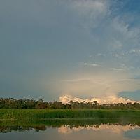 Thunderheads billow over the Amazon Jungle and Yanayacu River in Peru.