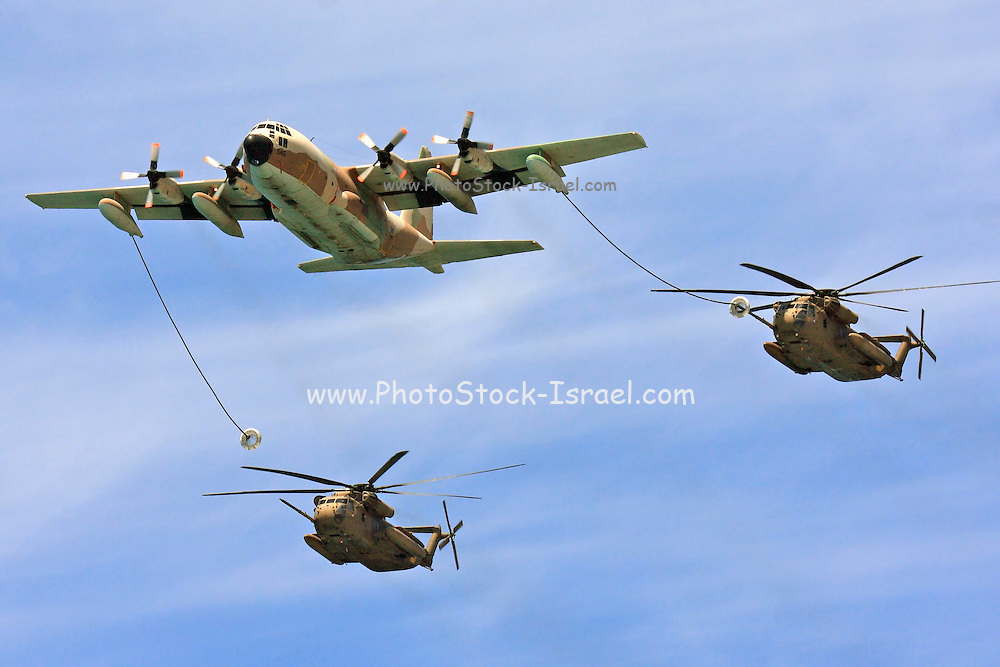 Israeli Air force Hercules C-130 transport plane refuelling two Sikorsky CH 53 helicopters in flight. During the 60th independence day parade May 8th 2008