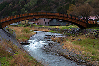 This bridge crosses the Narai River, which runs parallel to the main street. Extending 30 meters, it is one of the longest arched wooden bridges in Japan.  It is one of the icons of Narai Juku one of the pot towns along the Nakasendo Road.  During the Edo Period, Narai marked the halfway point between Kyoto and Edo/Tokyo for travelers along the Nakasendo Route. It was one of the most prosperous post towns along the Naka Sendo, now mostly just a tourist town but not without interest.