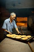 Close up of baker preparing fresh bread in bakery, Casablanca, Morocco