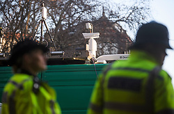 © Licensed to London News Pictures. 17/12/2018. London, UK.  Police officers stand in front of cameras on the roof of a van as the Metropolitan police trial facial recognition technology on members of the public in central London. The surveillance software is being used overtly with a uniformed presence. Privacy campaigners have expressed concerns about the use of the technology. Photo credit: Ben Cawthra/LNP