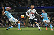 Christian Eriksen (Tottenham Hotspur) has the ball taken off him by Vincent Kompany (Captain) (Manchester City) during the Barclays Premier League match between Manchester City and Tottenham Hotspur at the Etihad Stadium, Manchester, England on 14 February 2016. Photo by Mark P Doherty.