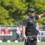 UNCW Head Coach Paul Cairney gives direction against Elon Sunday October 5, 2014. (Jason A. Frizzelle)