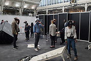 Exhibition visitors In a virtual environment of Whist, Whist offer to take the viewers into a journey into the unconscious mind, Virtual Reality Show, Business Design Centre, Islington. London.  21 April 2017